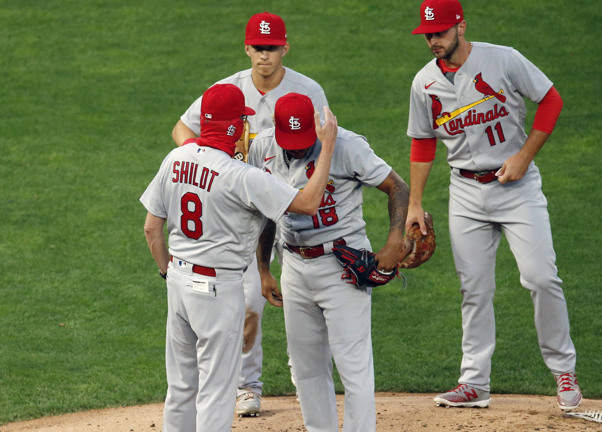 St. Louis Cardinals manager Mike Shildt (8) consoles pitcher Carlos Martinez on the cap as he p ...