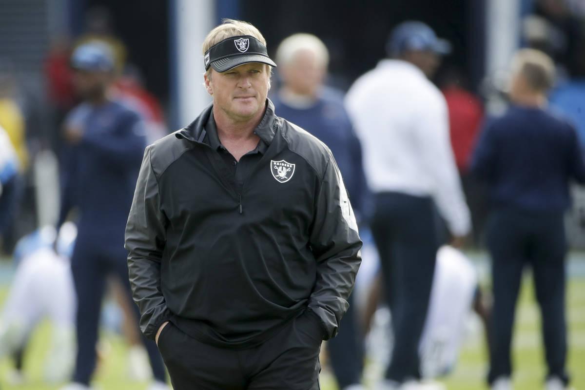 Oakland Raiders head coach Jon Gruden watches during warm ups before an NFL football game again ...