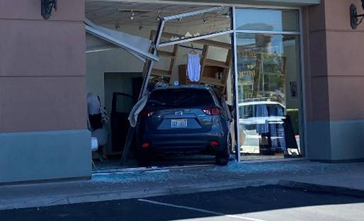 Police investigate an SUV crash Saturday, Aug. 1, 2020, into Barre3, a fitness studio at 120 S. ...