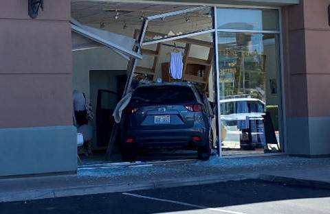 Police investigate an SUV crash Saturday, Aug. 1, 2020, into Barre3, a fitness studio at 120 S. ...