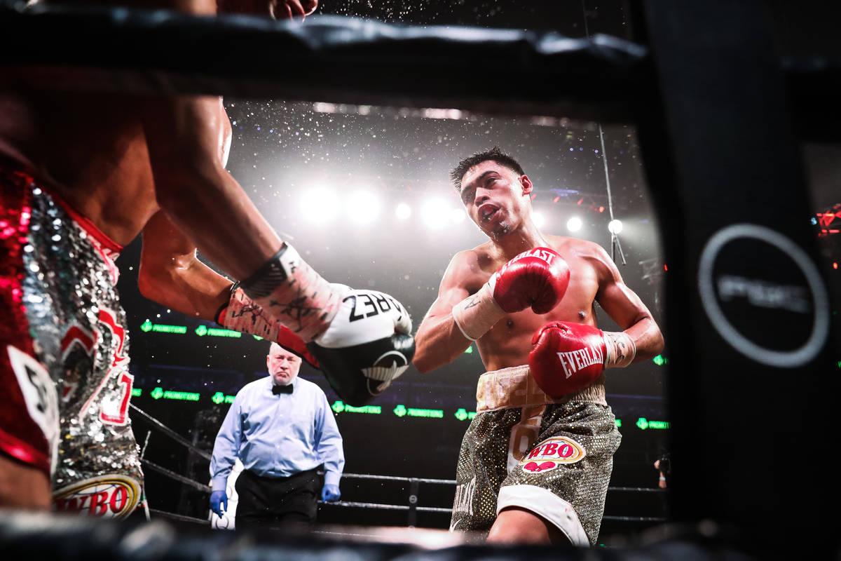 Angelo Leo (right) fights Cesar Juarez on Dec. 28, 2019, at State Farm Arena in Atlanta, Georgi ...
