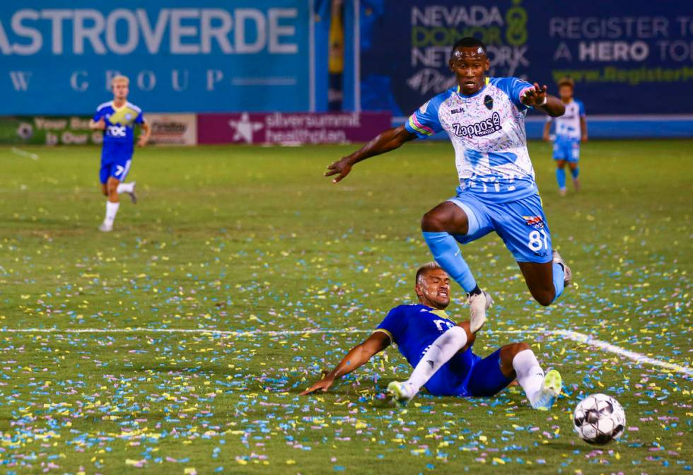 Las Vegas Lights FC's Rashawn Dally (81) chases after the ball while jumping over Reno 1868 FC' ...