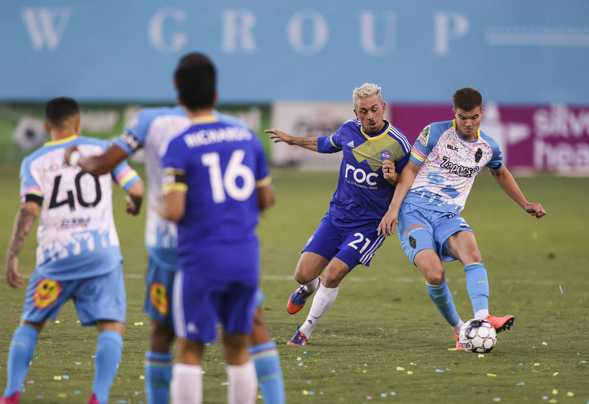 Las Vegas Lights FC's Johnny Fenwick (3) moves the ball under pressure from Reno 1868 FC's Core ...