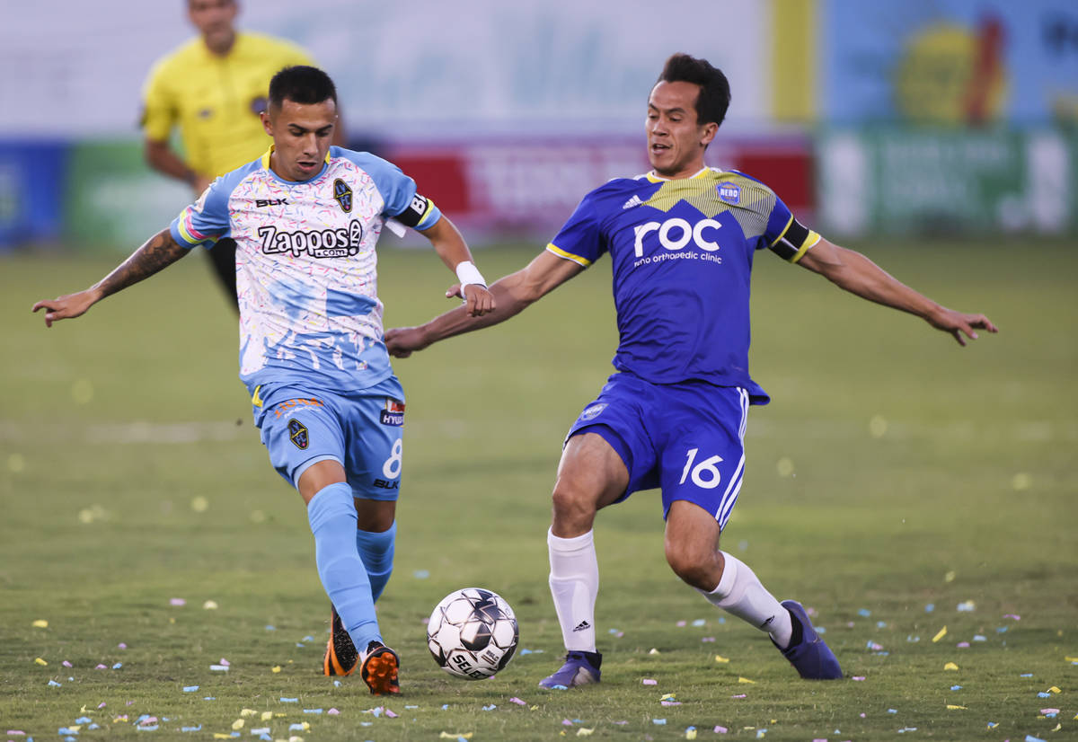 Las Vegas Lights FC's Jose Carrera battles for the ball against Reno 1868 FC's Brent Richards ( ...