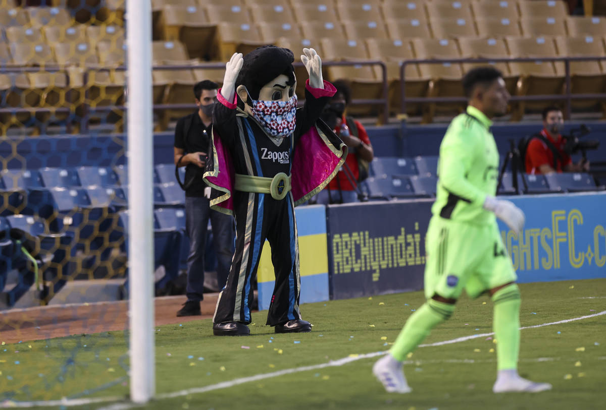 Las Vegas Lights FC mascot Cash reacts during the first half of a USL soccer game against Reno ...