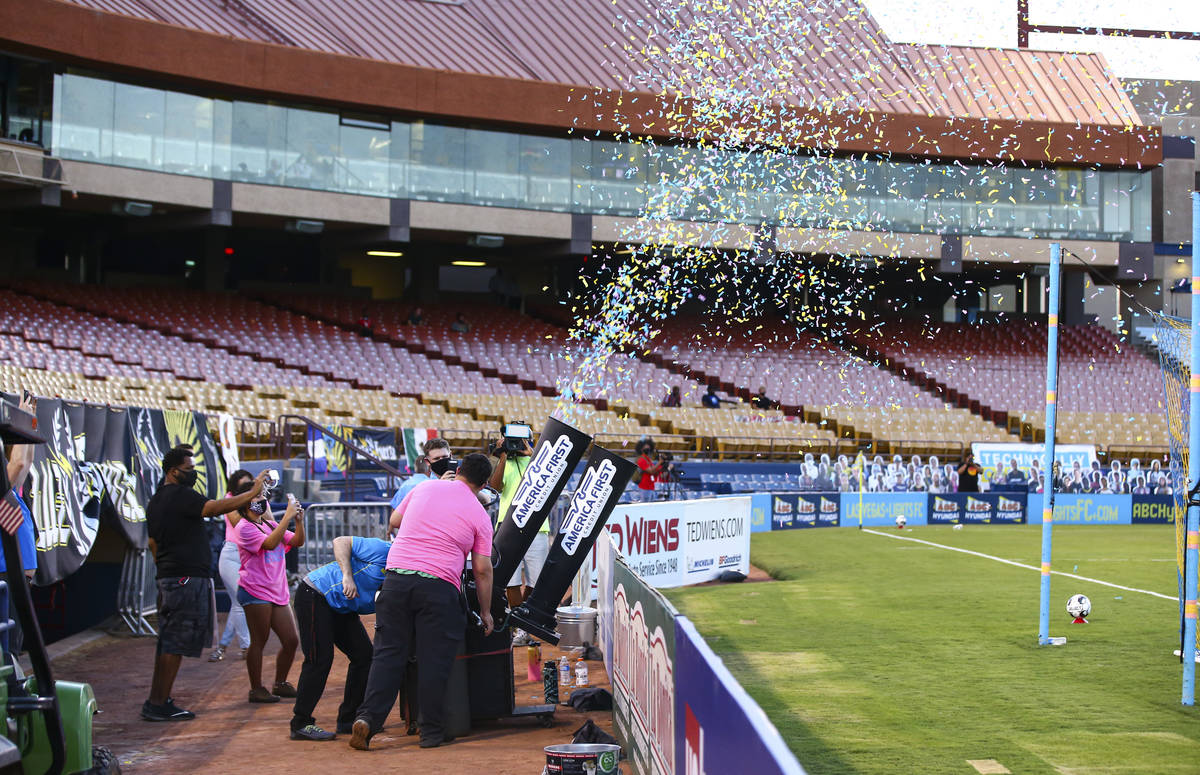 A confetti canon goes of among a backdrop of empty seats without fans during the first half of ...