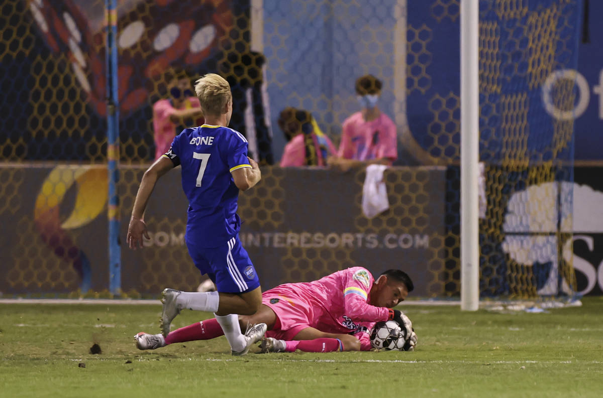 Las Vegas Lights FC goalkeeper Edward Delgado (0) stops the ball in front of Reno 1868 FC's Tuc ...