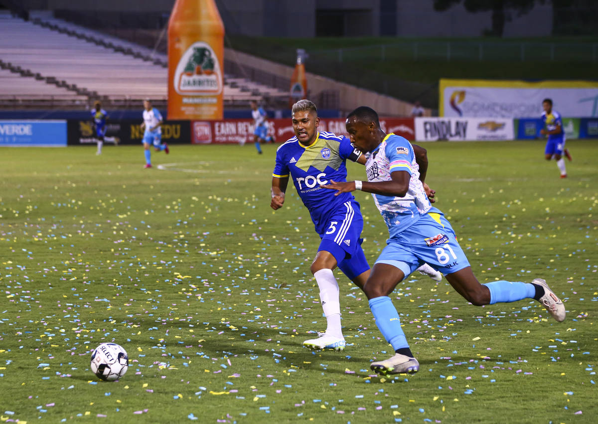 Las Vegas Lights FC's Rashawn Dally (81) chases after the ball against Reno 1868 FC's Tony Alfa ...