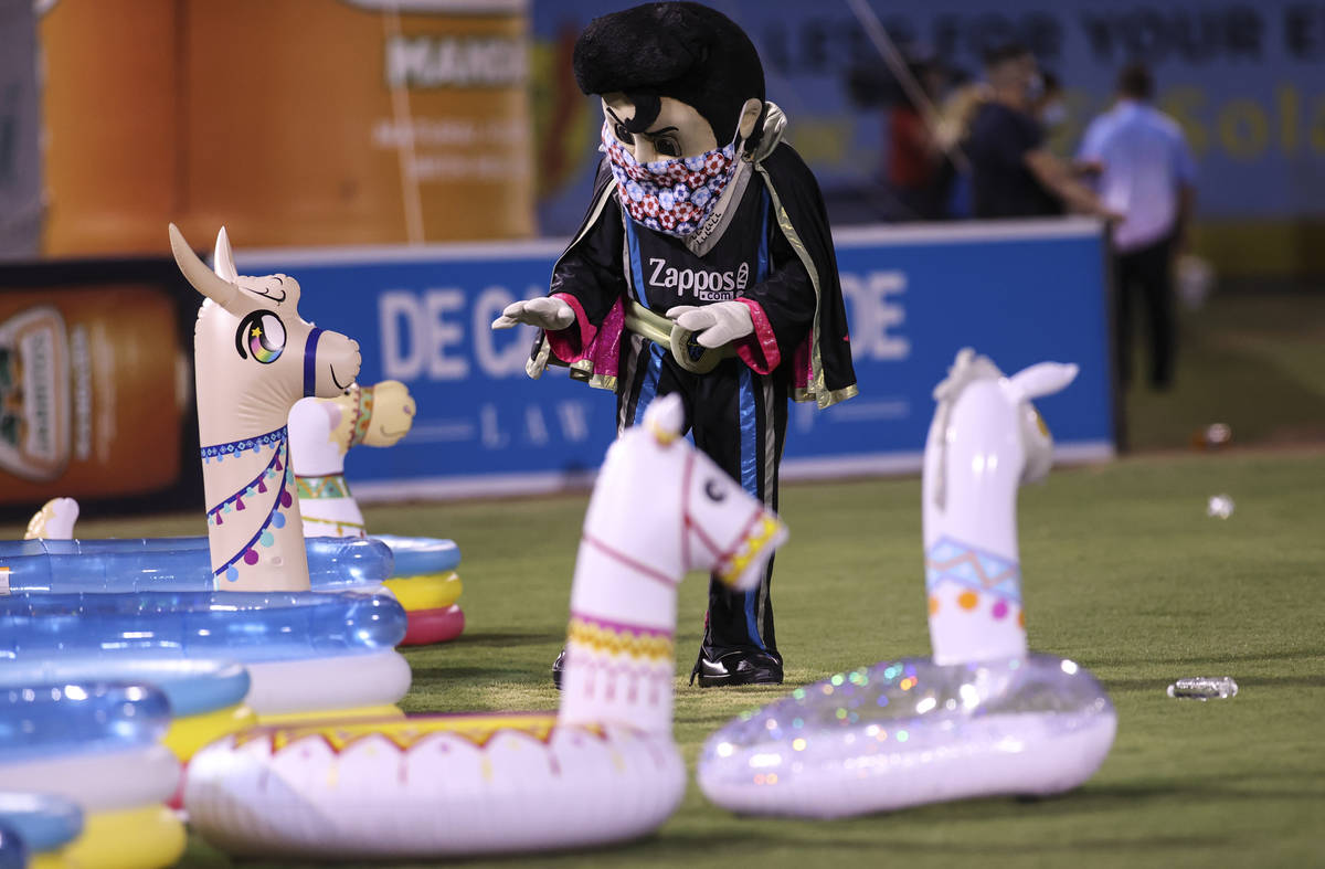 Las Vegas Lights FC mascot Cash interacts with blowup llamas during the second half of a USL so ...