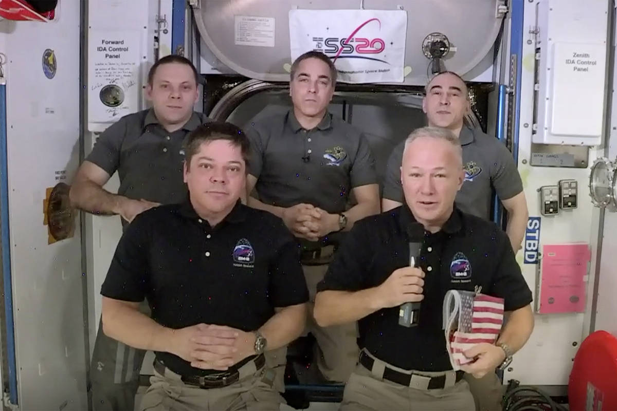 This photo provided by NASA shows, from left, front, astronauts Bob Behnken and Doug Hurley dur ...