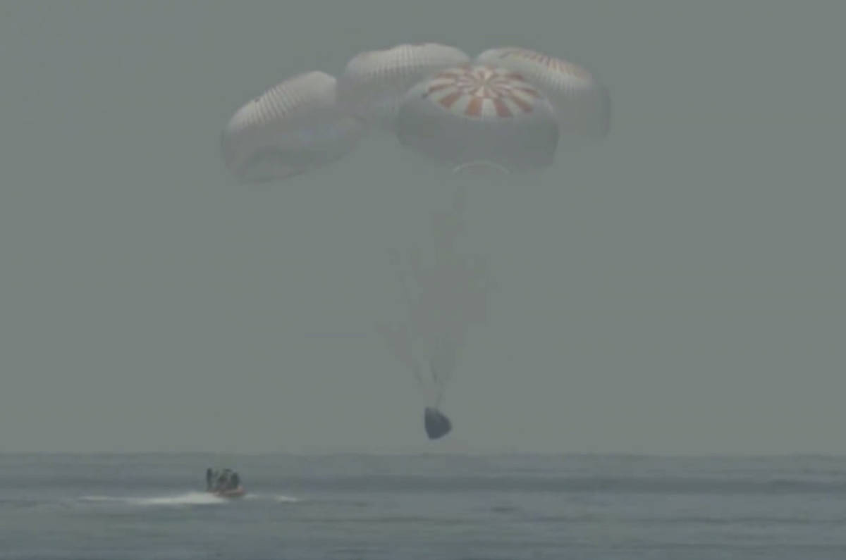 In this frame grab from NASA TV, the SpaceX capsule splashes down Sunday, Aug. 2, 2020 in the G ...