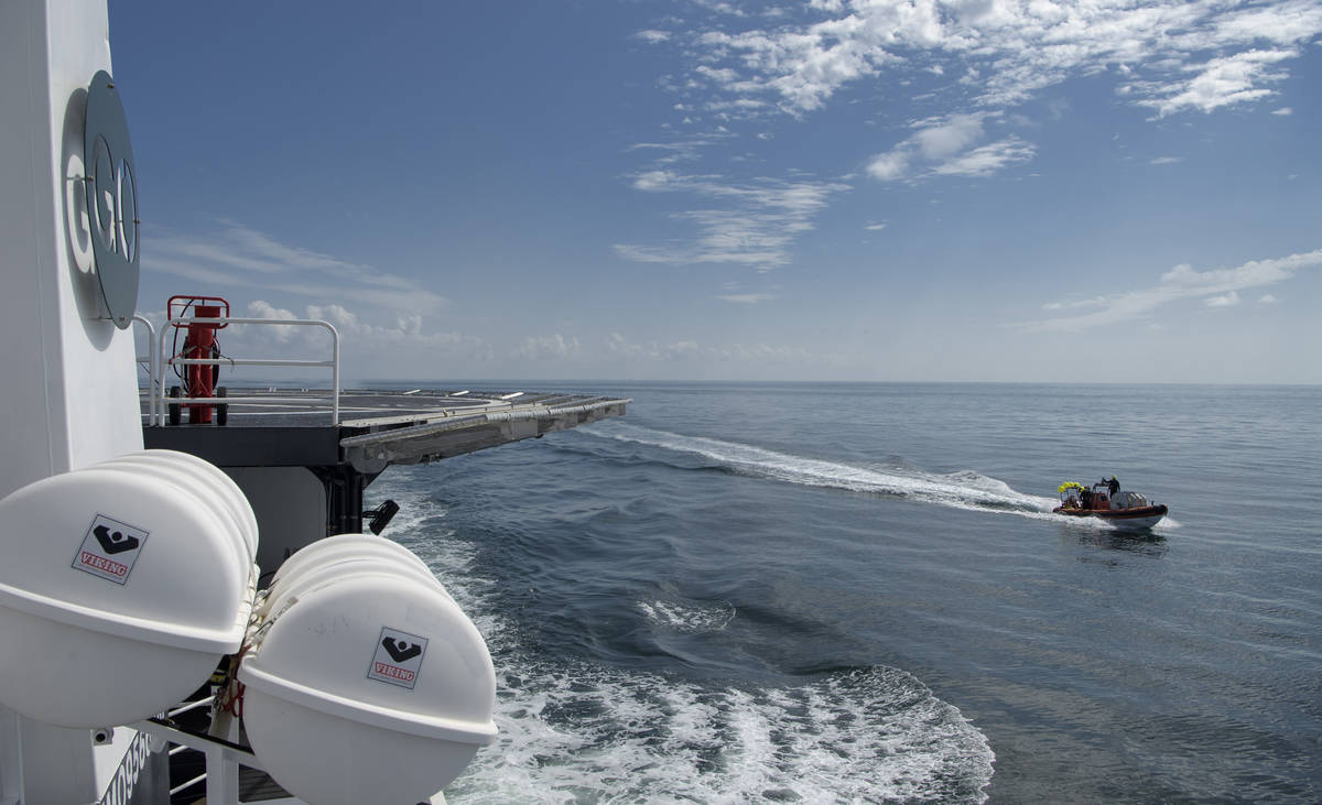 SpaceX support teams are deployed on fast boats from the SpaceX GO Navigator recovery ship ahea ...