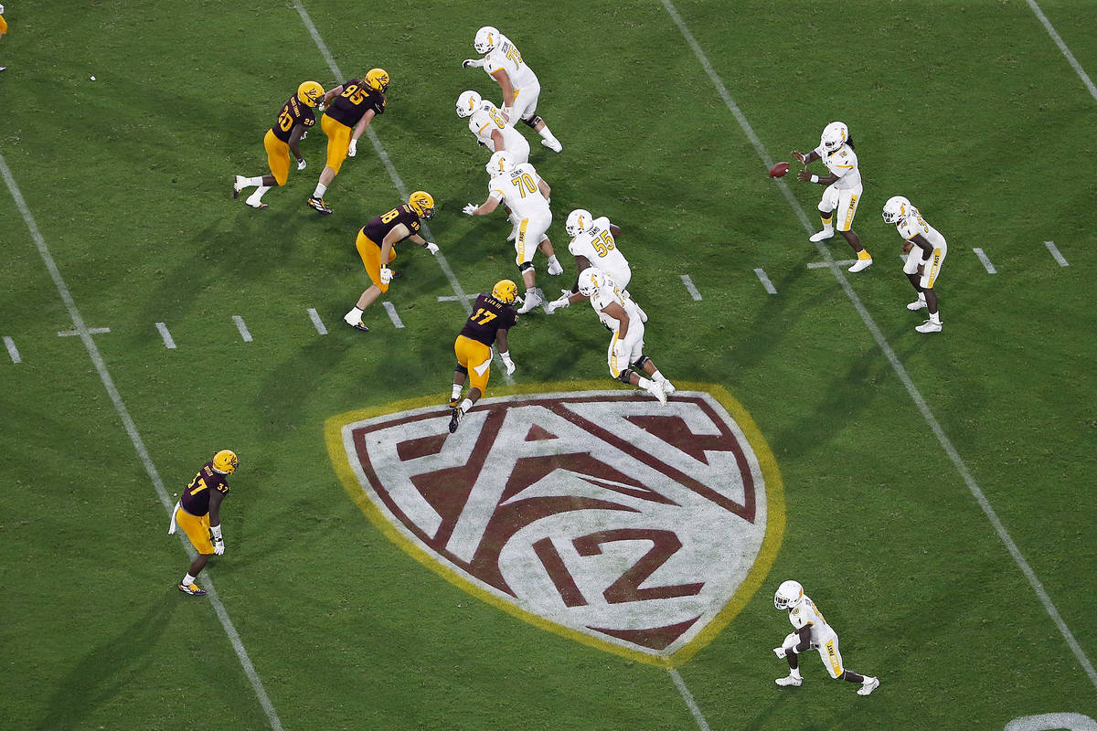 FILE - This Thursday, Aug. 29, 2019, file photo, shows the Pac-12 logo during the second half o ...