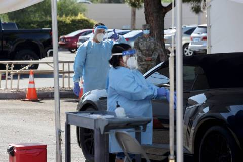 UNLV Medicine certified medical assistants and Nevada National Guard members test curbside for ...