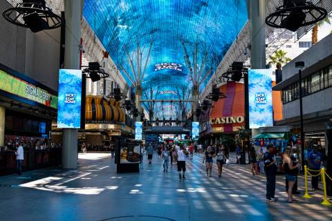 Health and safety messages are displayed at the Fremont Street Experience in downtown Las Vegas ...