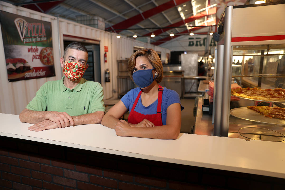 Jorge Bañuelos, left, and his wife Gaby, owners of ViPizza, at Broadacres Marketplace in North ...