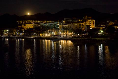 The Sturgeon moon rises above the shops at Lake Las Vegas on Monday, August 3, 2020, in Henders ...