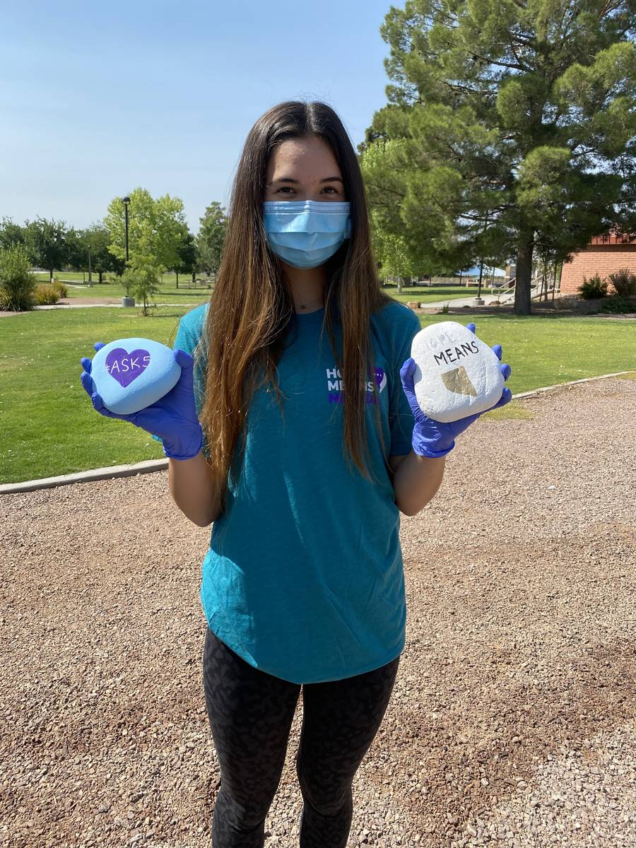 Caroline Edgeworth, 16, holding up rocks painted with positive messages. She and her sister Lau ...