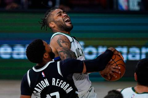 Milwaukee Bucks guard Frank Mason III (15) is fouled as he shoots by Brooklyn Nets guard Garret ...