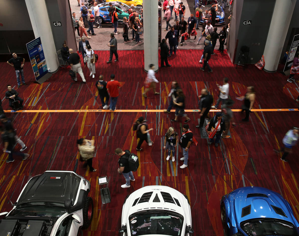 People attend the SEMA show at the Las Vegas Convention Center in Las Vegas, Tuesday, Nov. 5, 2 ...