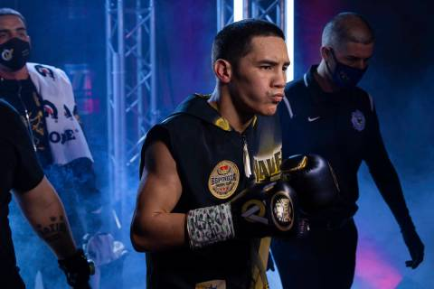Oscar Valdez, front/right, enters the ring before the start of his jr. lightweight fight with J ...