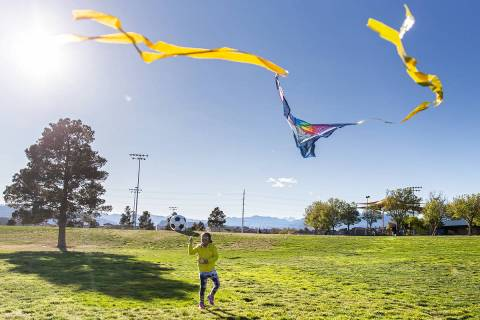 Las Vegas residents take advantage of the open space at Desert Breeze Park flying kites on Frid ...