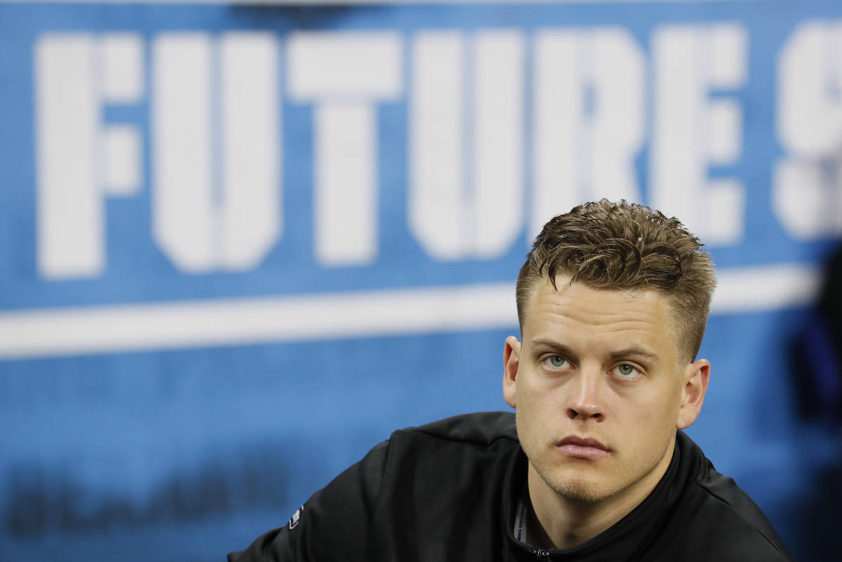 In this Feb. 27, 2020, file photo, LSU quarterback Joe Burrow watches a drill at the NFL footba ...