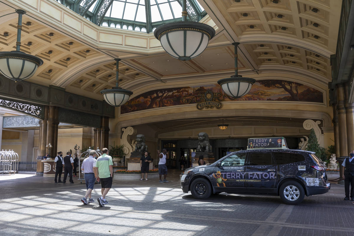 Guests walk to the Bellagio on the Las Vegas Strip, Thursday, Aug. 6, 2020, in Las Vegas. (Eliz ...