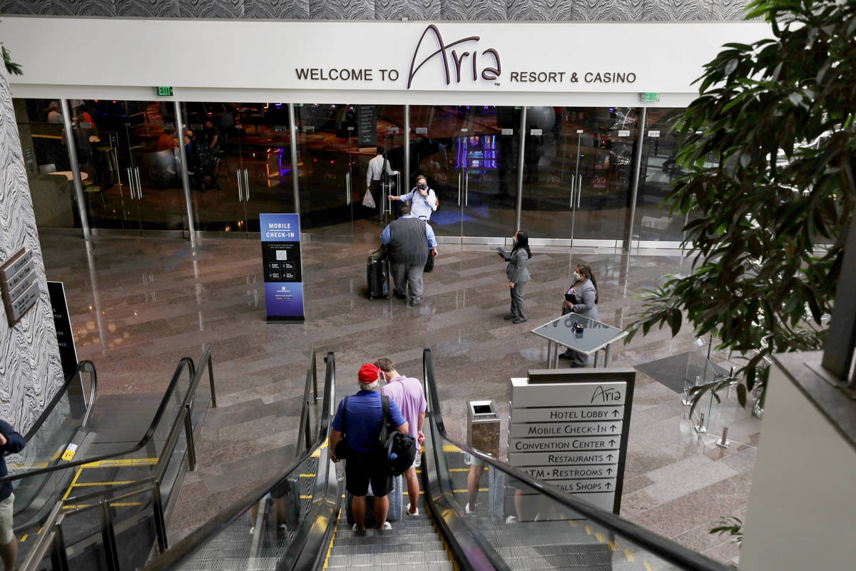 Guests enter Aria on the Las Vegas Strip, Thursday, Aug. 6, 2020, in Las Vegas. (Elizabeth Brum ...