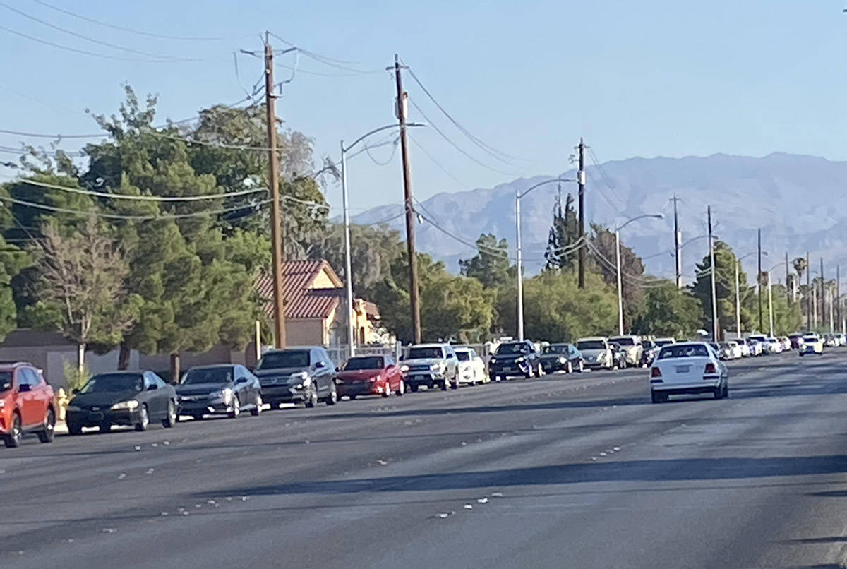 A food distribution for Las Vegas families in need prompted a mile-plus-long line of motorists ...
