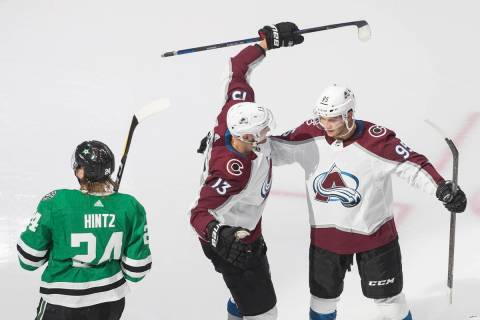 Dallas Stars' Roope Hintz (24) skates past as Colorado Avalanche's Valeri Nichushkin (13) and A ...