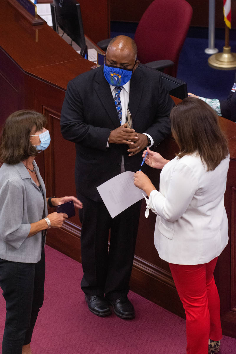 Assembly Speaker Jason Frierson speaks with Assembly Minority Co-Leader Robin Titus, left, and ...
