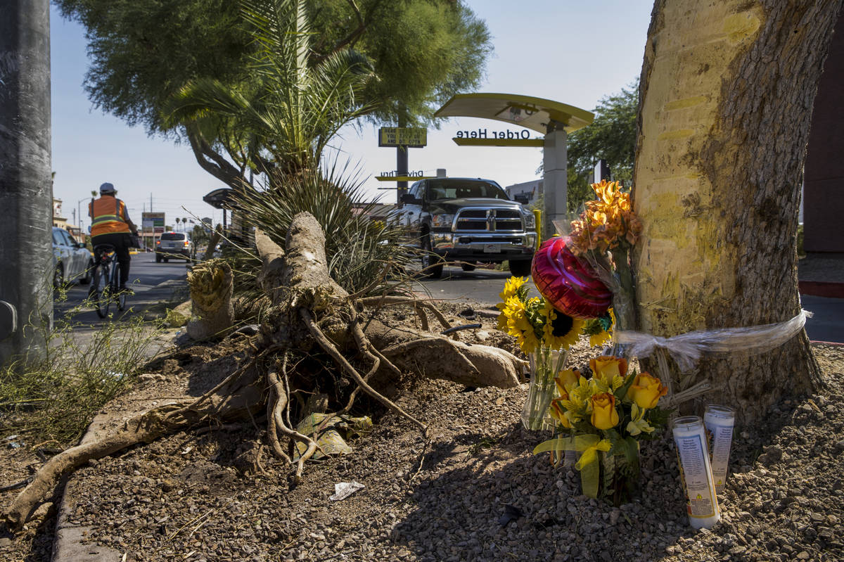 A small memorial sits near downed tree limbs where two teenage girls were struck and killed by ...
