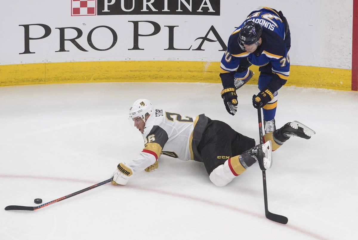 St. Louis Blues' Oskar Sundqvist (70) checks Vegas Golden Knights Paul Stastny (26) during the ...