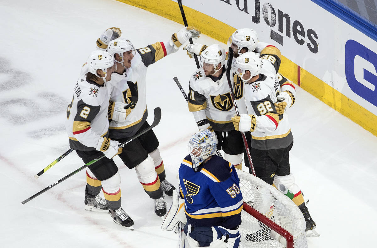 St. Louis Blues goalie Jordan Binnington (50) looks on as the Vegas Golden Knights celebrate a ...
