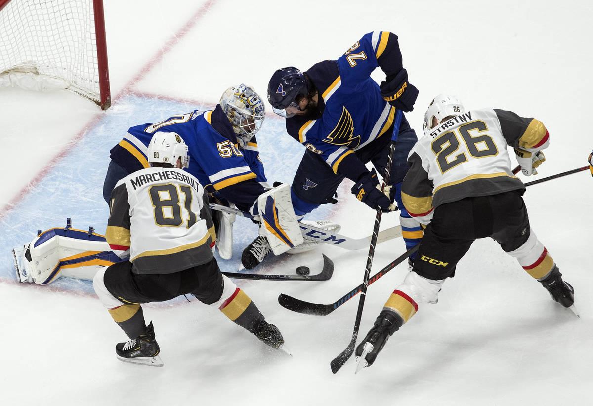 St. Louis Blues goalie Jordan Binnington (50) makes a save as teammate Justin Faulk (72), Vegas ...
