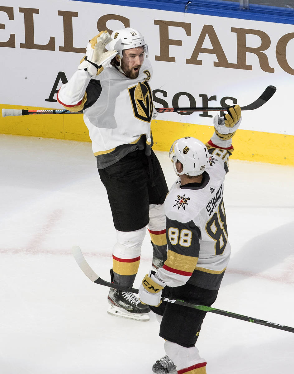 Vegas Golden Knights' Mark Stone (61) and Nate Schmidt (88) celebrate a goal against the St. Lo ...