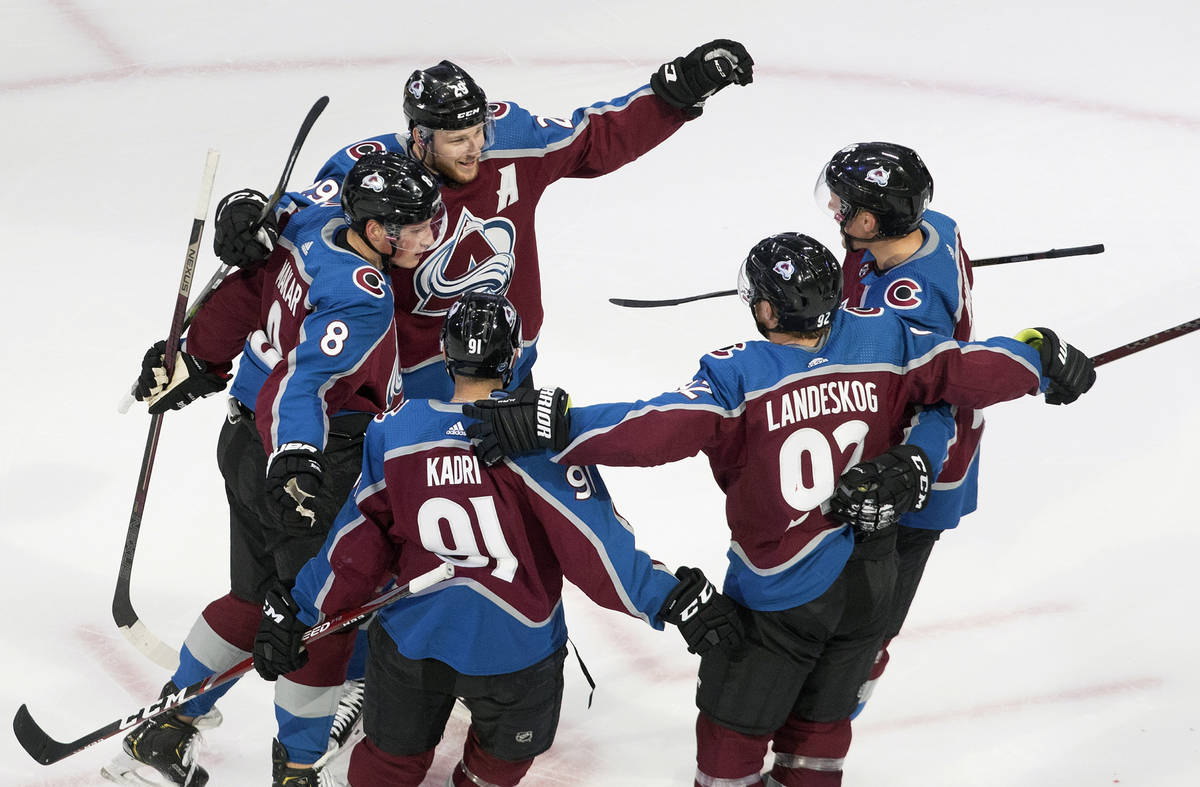 Colorado Avalanche players celebrate a goal during second period NHL hockey Stanley Cup qualify ...