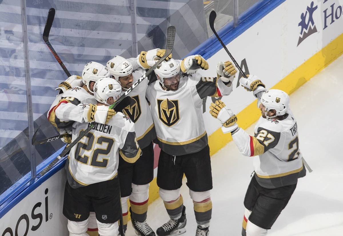 Vegas Golden Knights celebrate a goal during the econd period of an NHL Stanley Cup hockey qual ...