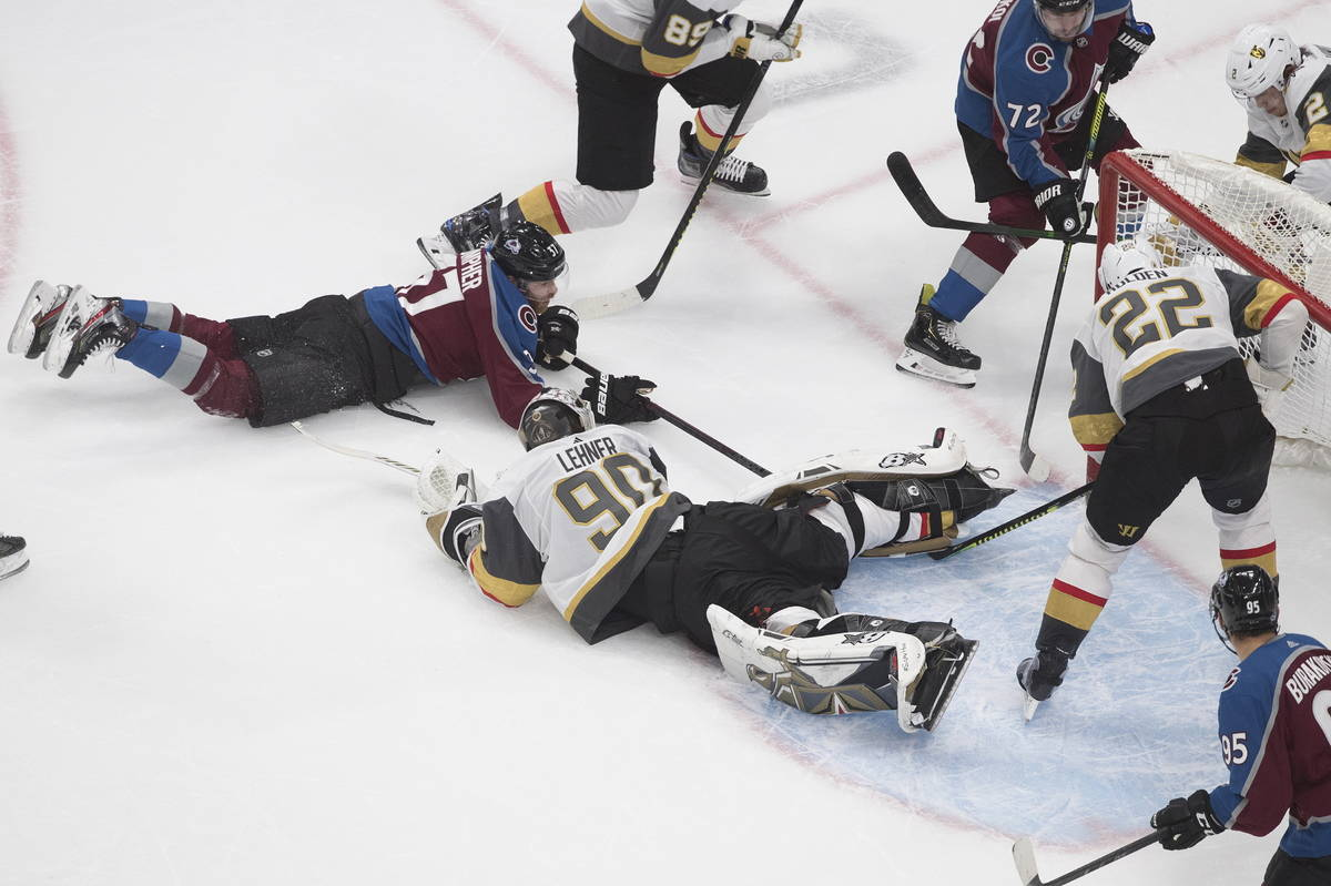 Colorado Avalanche's J.T. Compher (37), left, scores on Vegas Golden Knights goalie Robin Lehne ...