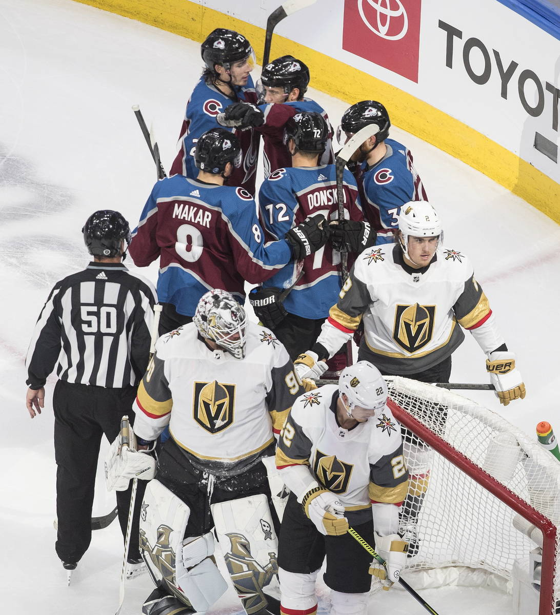 Colorado Avalanche players, rear, celebrate a goal during the second period of an NHL hockey qu ...