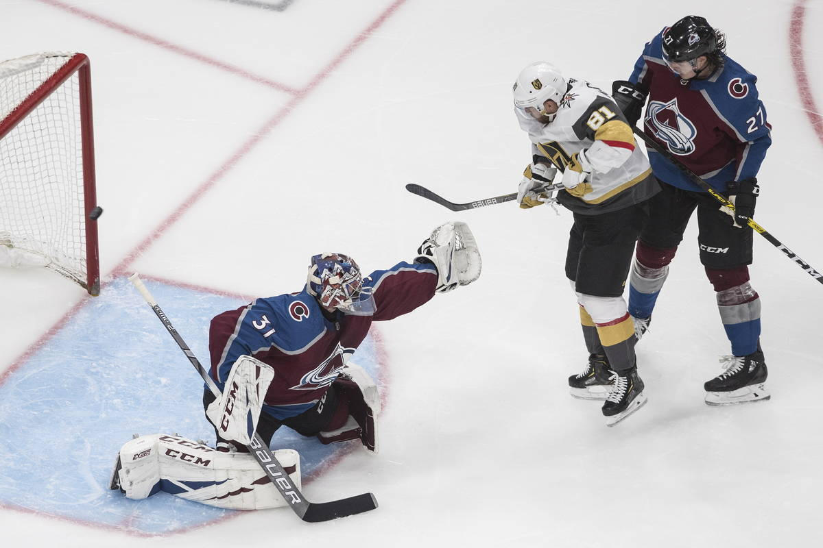 Colorado Avalanche' goalie Philipp Grubauer (31) is scored on as Vegas Golden Knights ' Jonatha ...