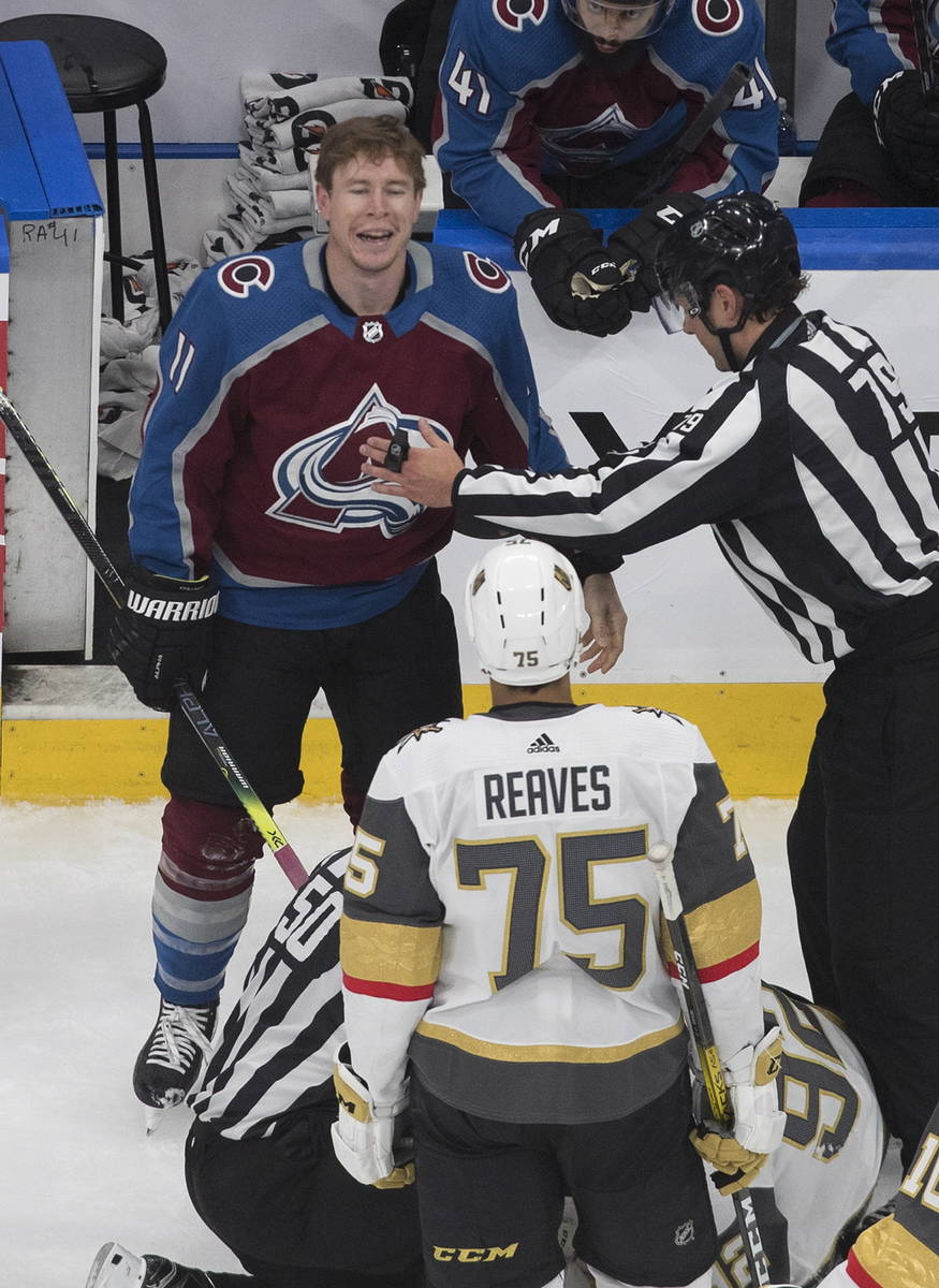 Colorado Avalanche's Matt Calvert (11) and Vegas Golden Knights' Ryan Reaves (75) exchange word ...