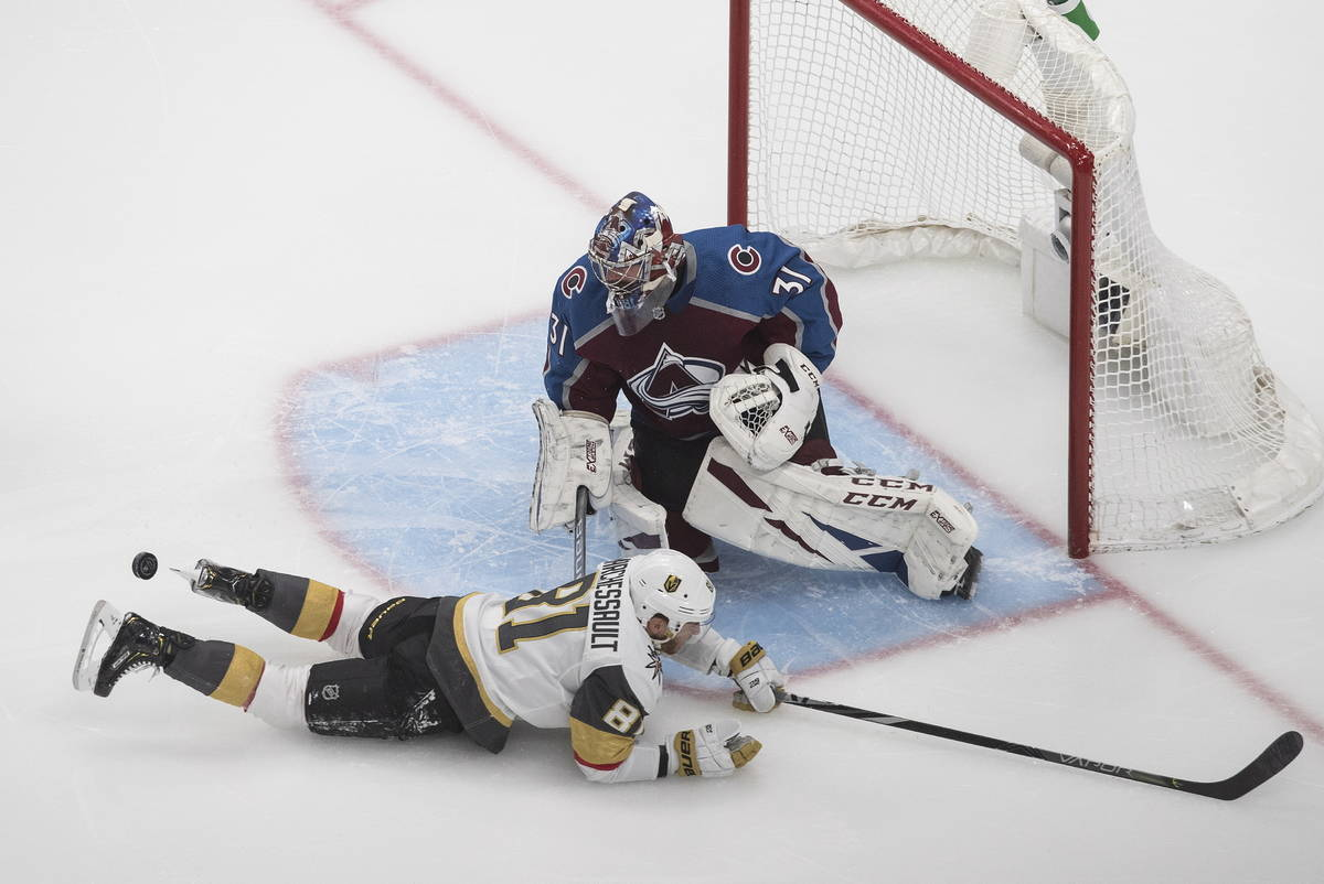 Colorado Avalanche goalie Philipp Grubauer (31) makes a save on Vegas Golden Knights' Jonathan ...