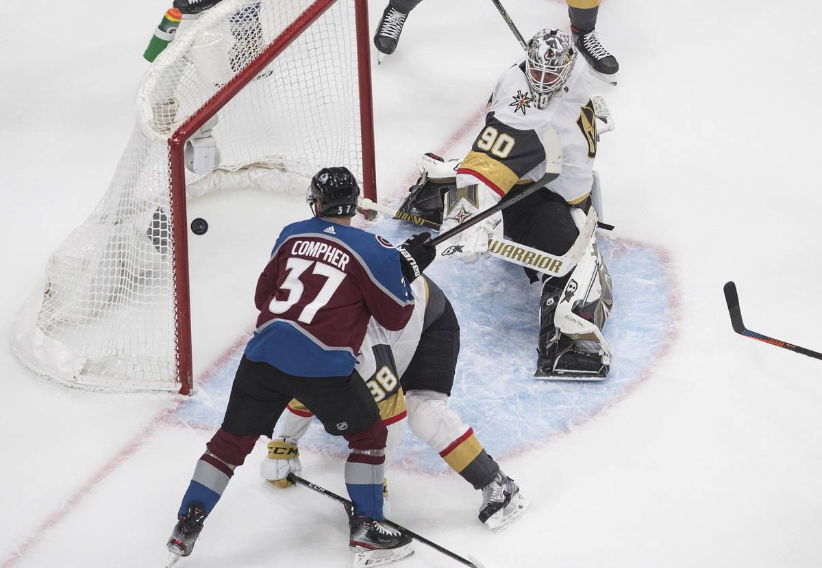 Colorado Avalanche's J.T. Compher (37) watches the puck go in past Vegas Golden Knights goalie ...
