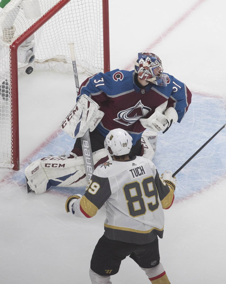 Colorado Avalanche goalie Philipp Grubauer (31) gives up a goal to Vegas Golden Knights' Alex T ...