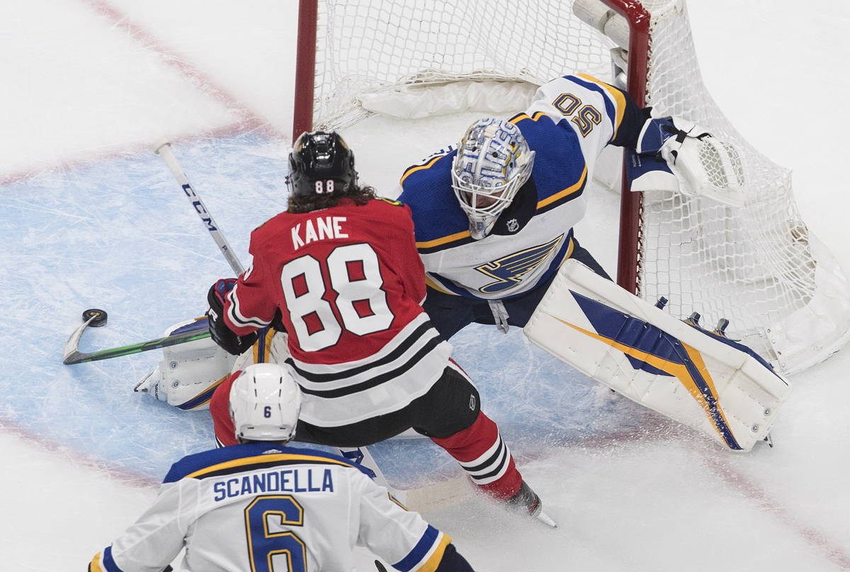 St. Louis Blues goalie Jordan Binnington (50) makes the save on Chicago Blackhawks' Patrick Kan ...
