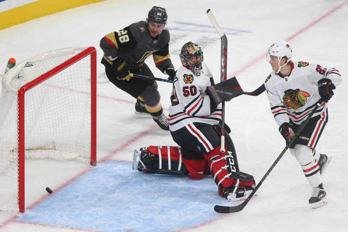 Vegas Golden Knights left wing William Carrier (28) looks on as a shot byright wing Ryan Reaves ...