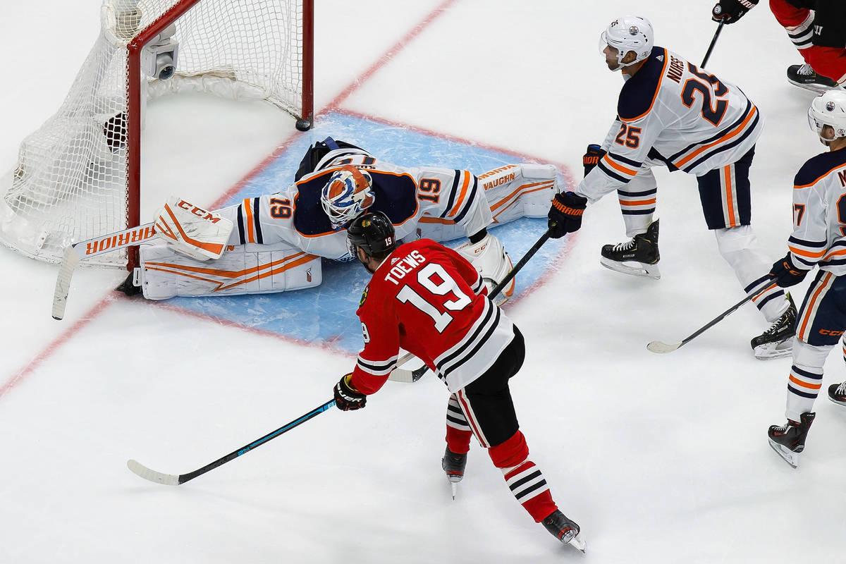 Edmonton Oilers goaltender Mikko Koskinen (19) makes a save against Chicago Blackhawks' Jonatha ...