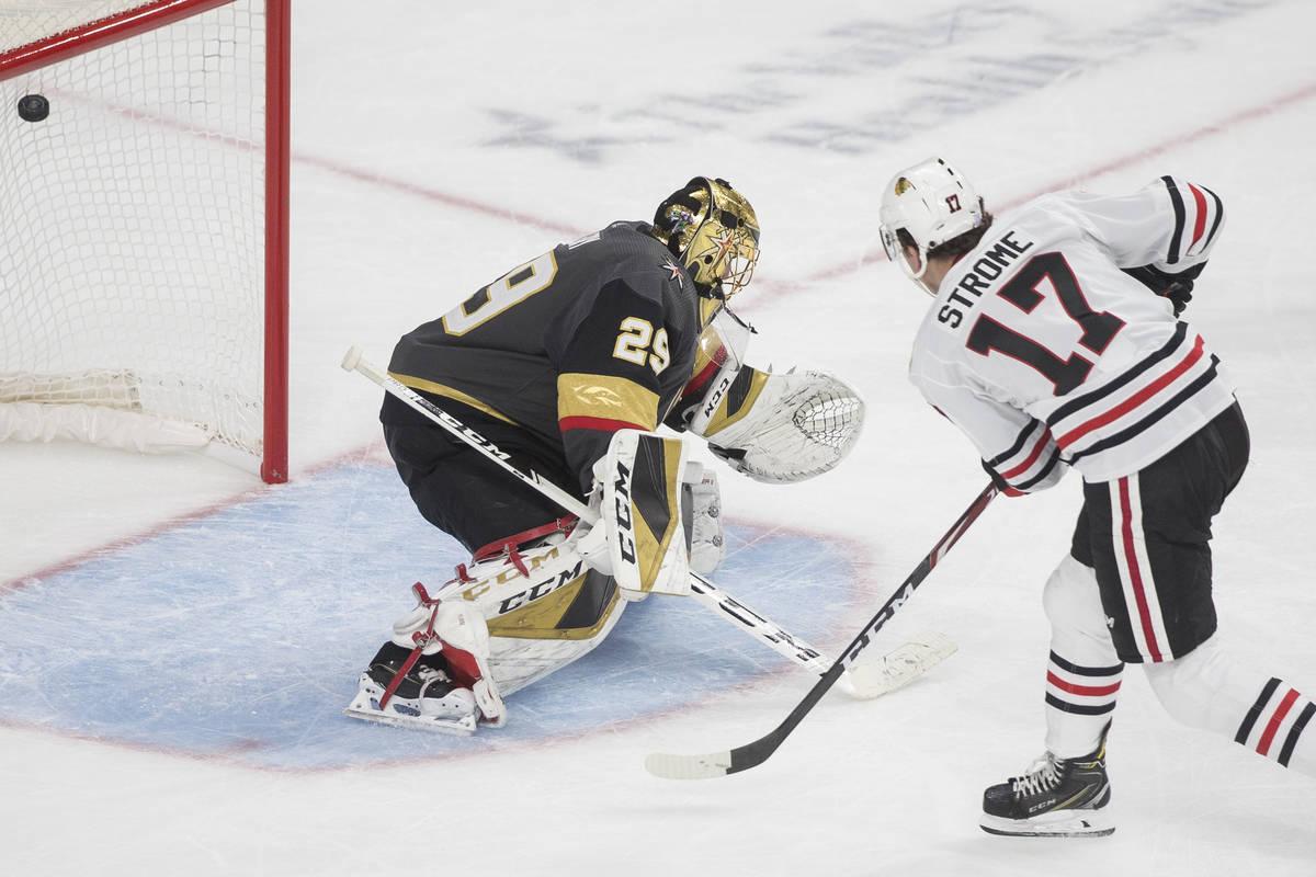 Chicago Blackhawks center Dylan Strome (17) scores on Vegas Golden Knights goaltender Marc-Andr ...